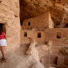 SWs015h: Visitor takes a closer look in side Spruce Tree House ruin at Mesa Verde National Park. Photo by Tom Stillo/CTO