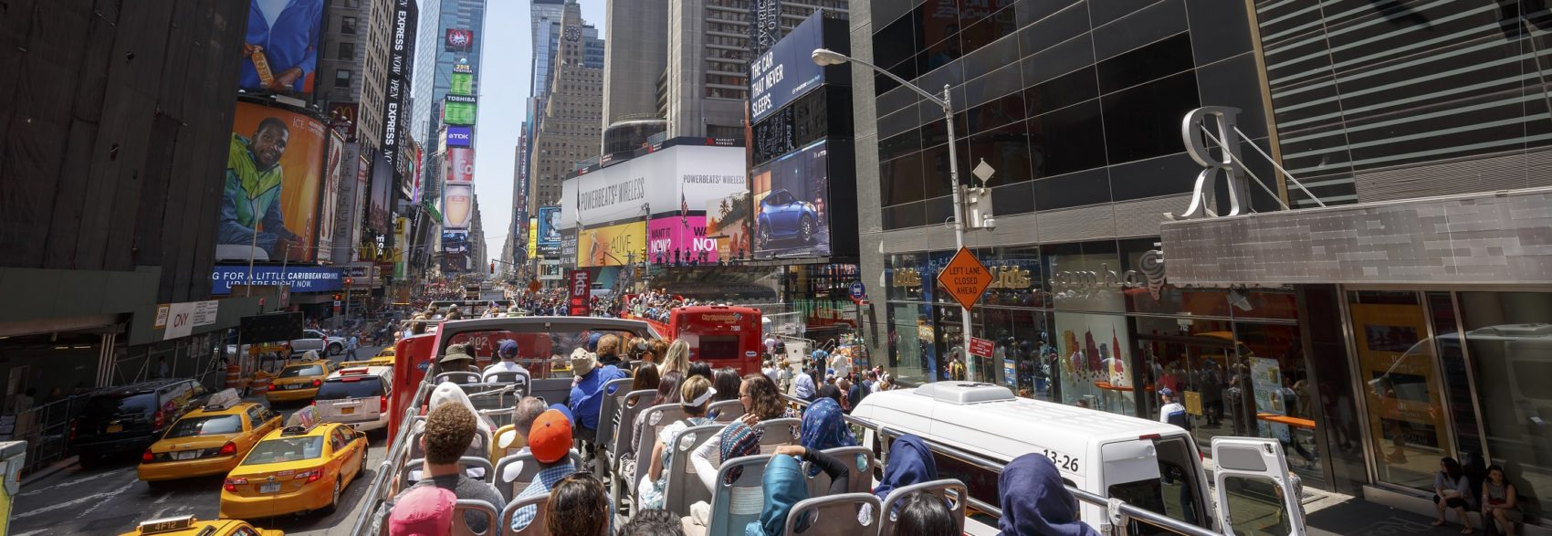Times Square with tourists in bus, New York City, USA