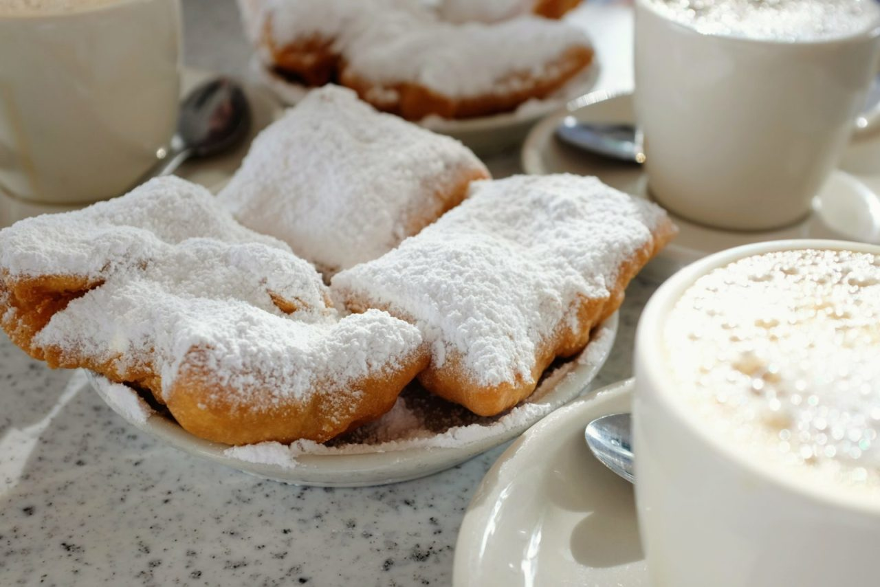 Café au lait and beignets at Café du Monde in New Orleans